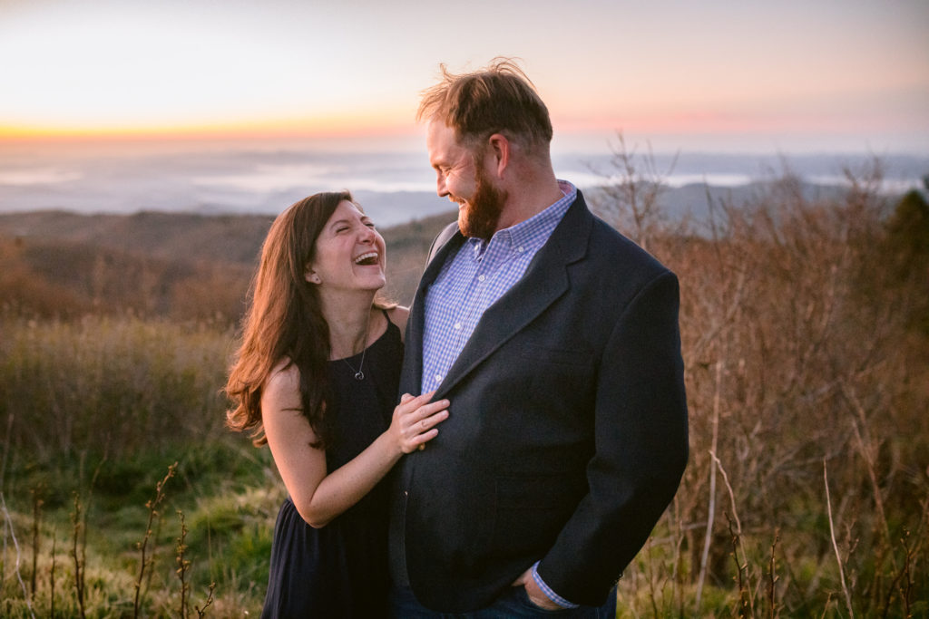 Laughing couple for engagement photos at black balsam mountain.