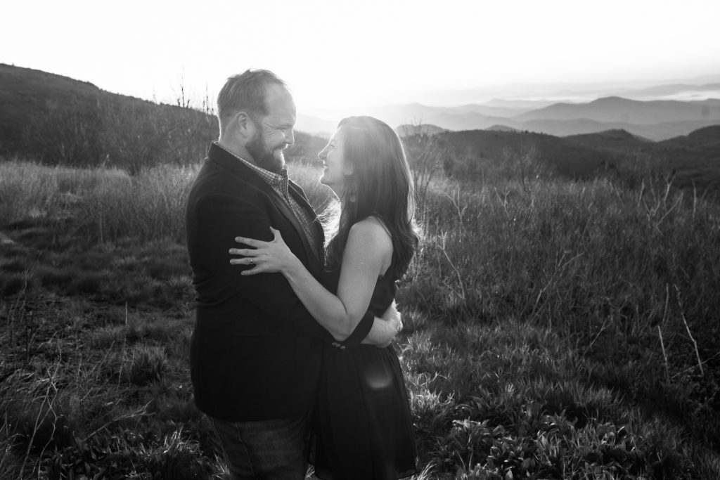 Black and white sunrise photo with an engaged couple.