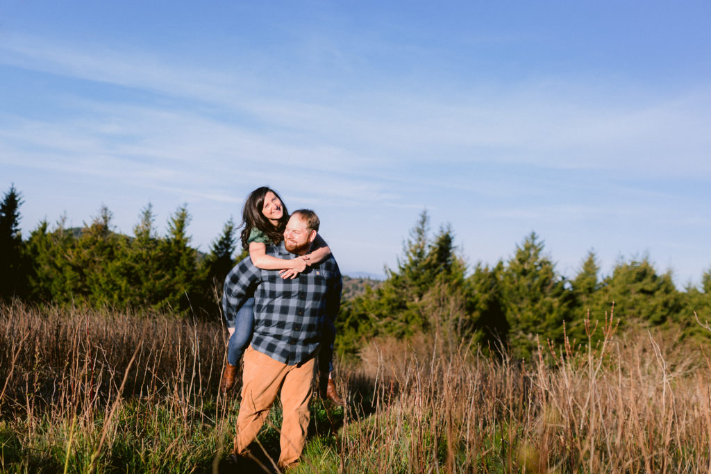 Sunny engagement session in the mountains at sunrise.