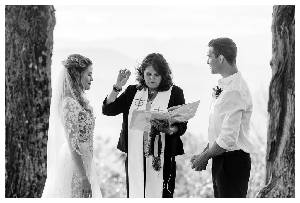black and white photo of couple eloping