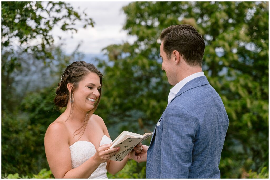 Sara laughing while reading her personal vows to Andrew.