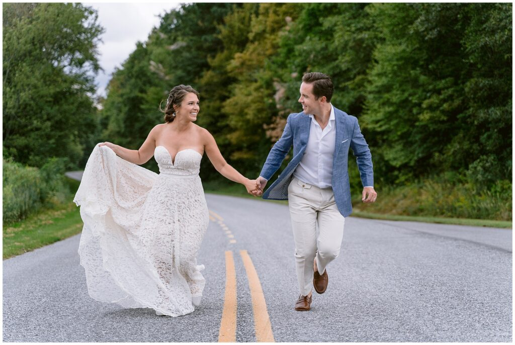 Bride and groom running up the street together after their vow exchange in the blue ridge mountains.