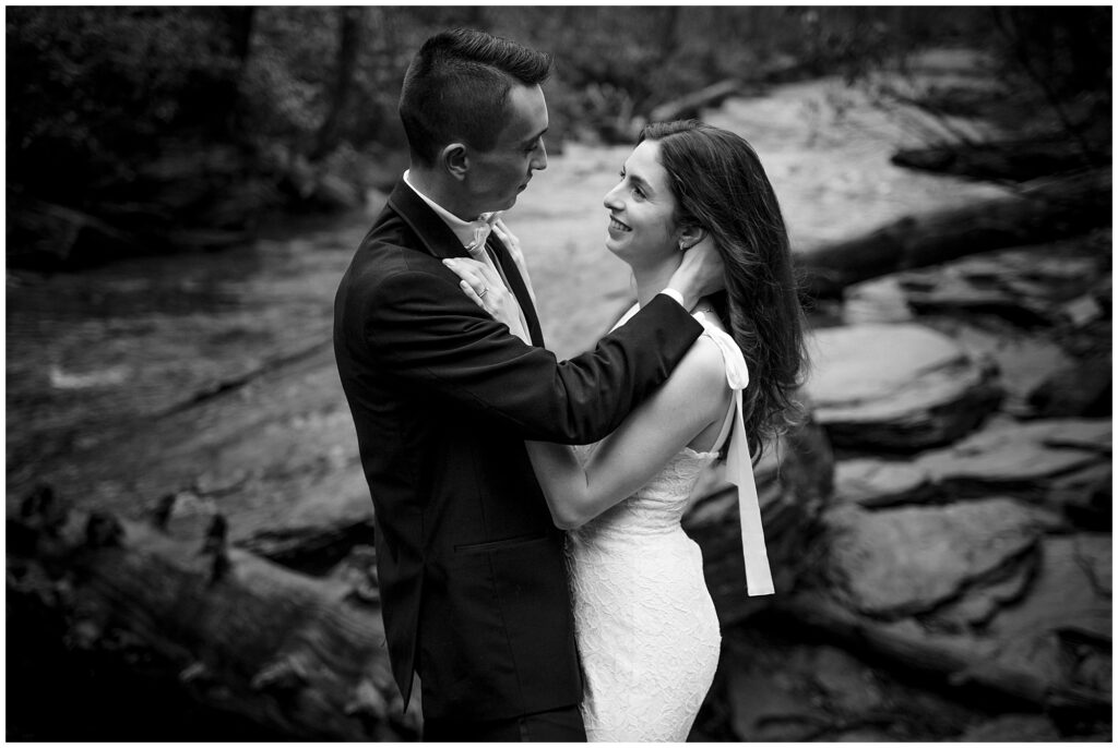 black and white bride and groom waterfall portrait in Asheville   Legacy & Legend All-Inclusive Elopement