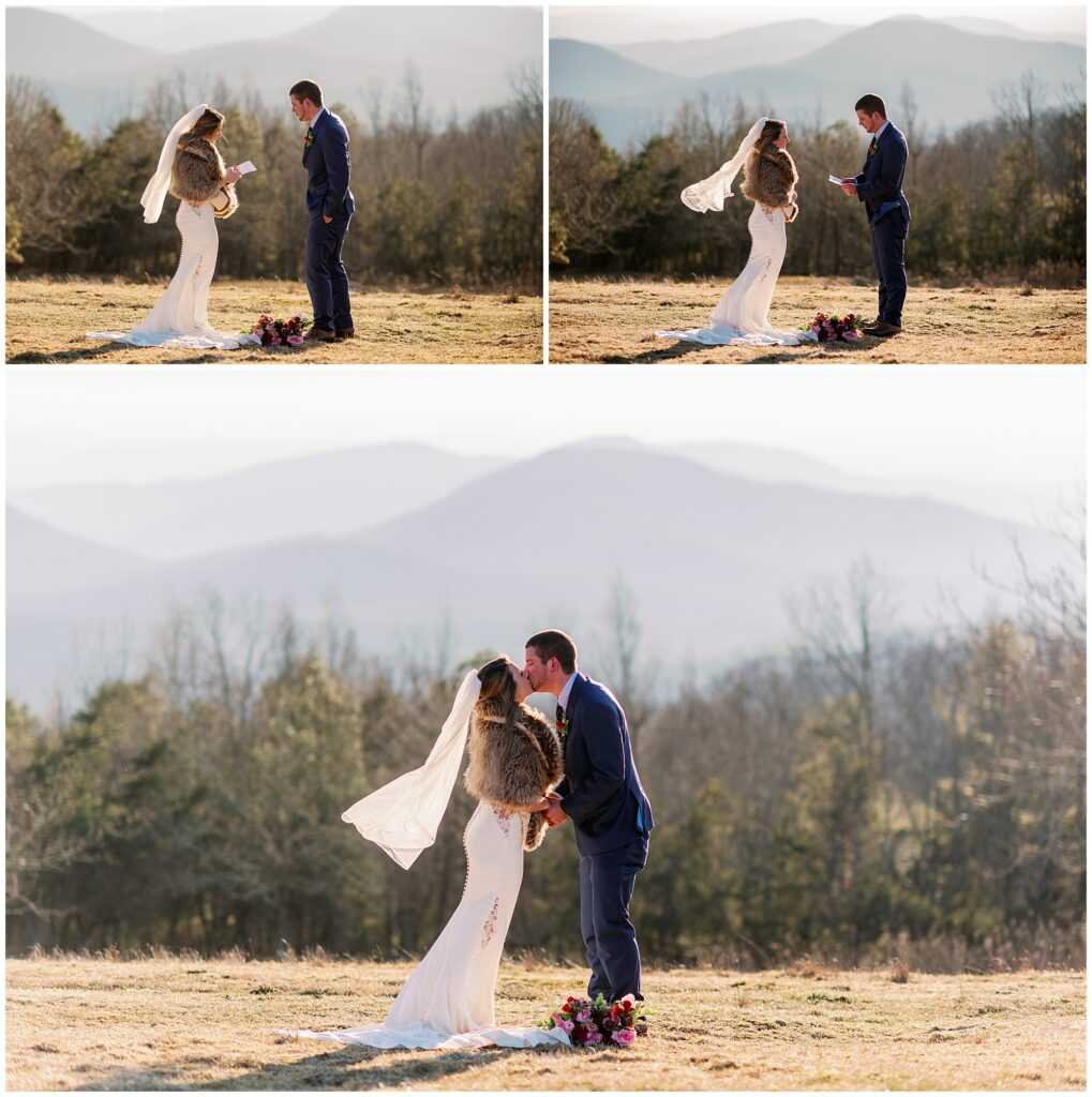 The bride and groom exchange vows and share their first kiss as husband and wife with rolling mountain views in the background.