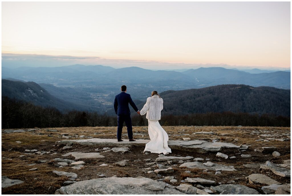 The bride and groom looking out at the mountains during their Bearwallow mountain elopement.