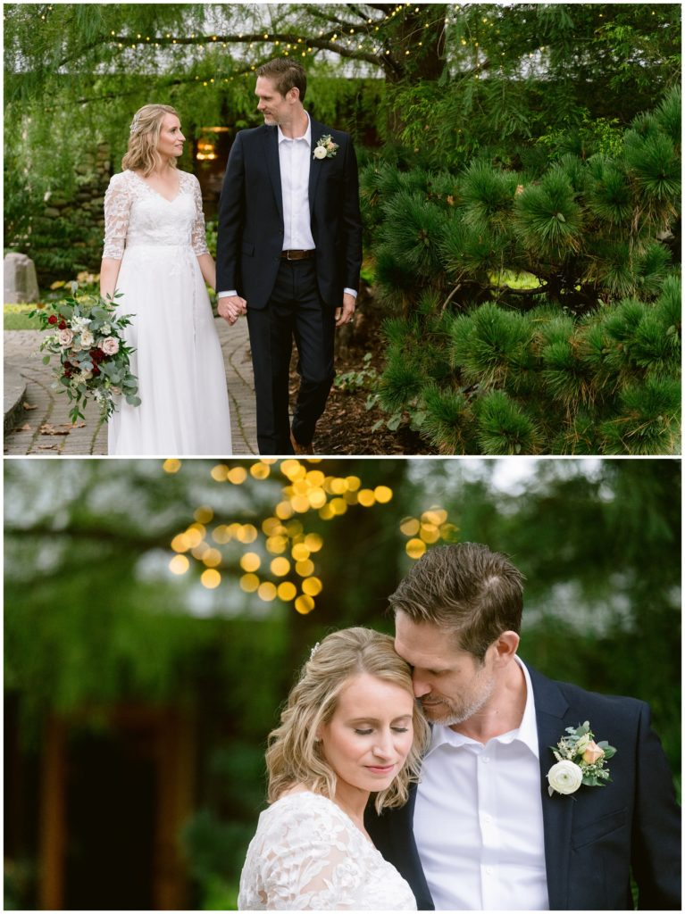 Bride and groom walking through a zen garden together after getting married.