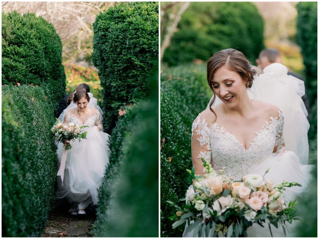 The bride walking through the garden to her elopement as her friends carry the train of her dress.