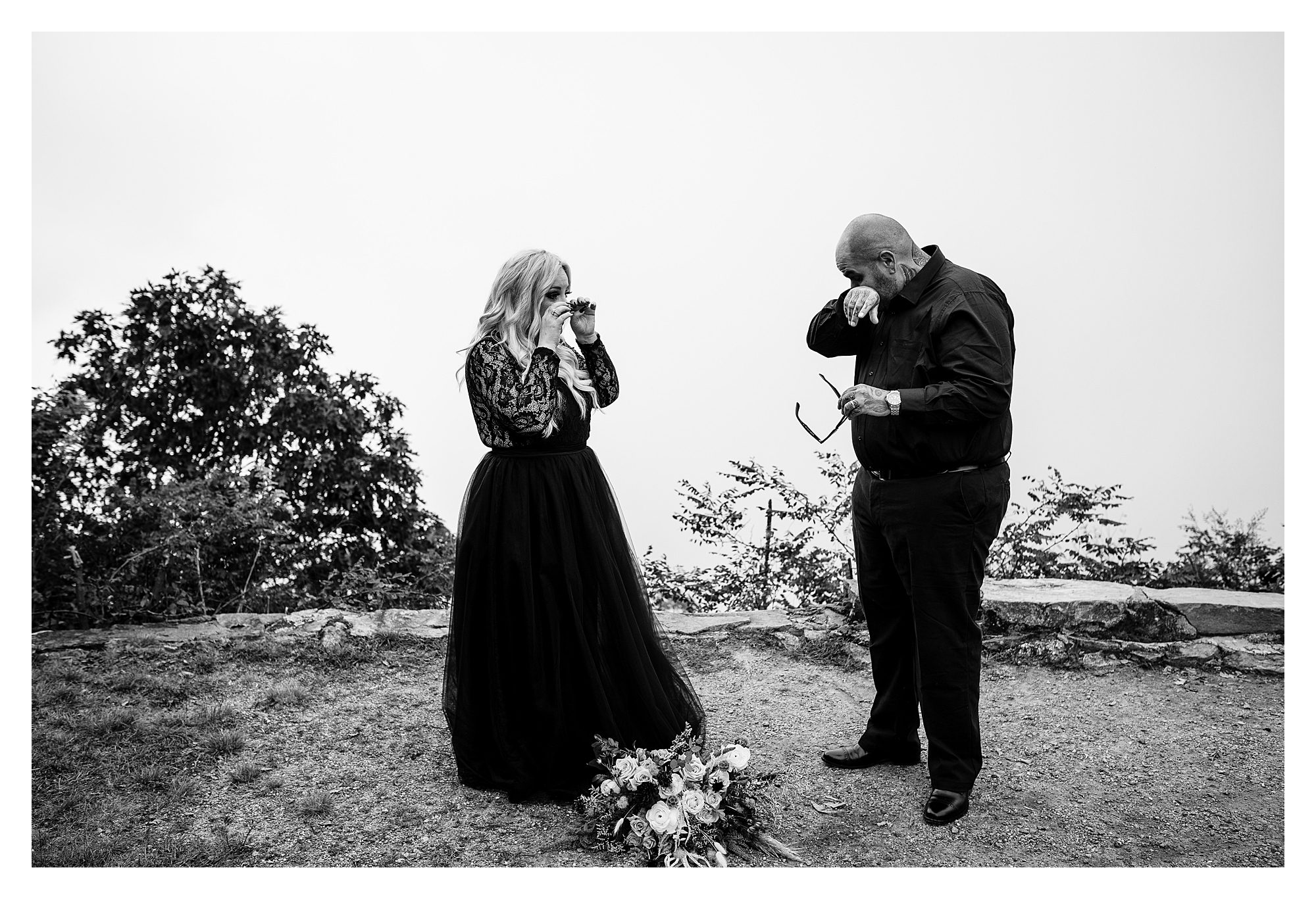 Black and white image of the bride and groom crying during their elopement in NC   Legacy and Legend